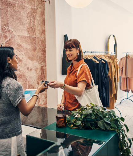 woman shopping for clothes, paying cashier with card